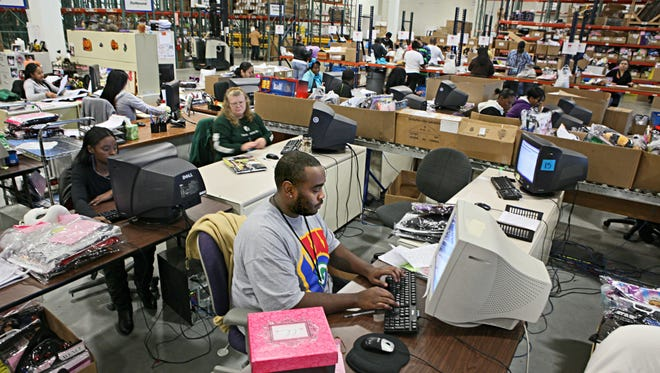 Employees at New Berlin's BuySeasons Inc. work on processing and crediting returns in this 2011 photo.