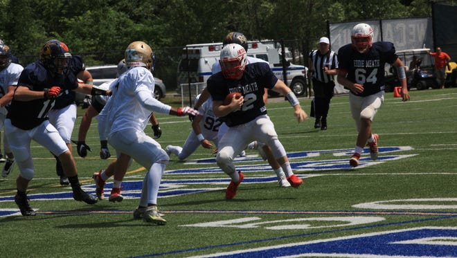 Johnathan Letta of Hilton plays on the West team during the Eddie Meath All-Star High School Football Game took place at Webster Thomas High School on Sunday, July 9, 2017.