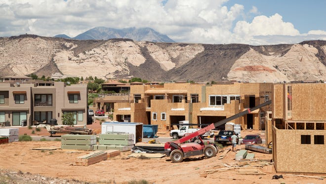 Construction crews continue building homes in the Ledges Wednesday, July 26, 2017. Local governments and city planners discuss the projected increase in population and the potential impacts on the area.
