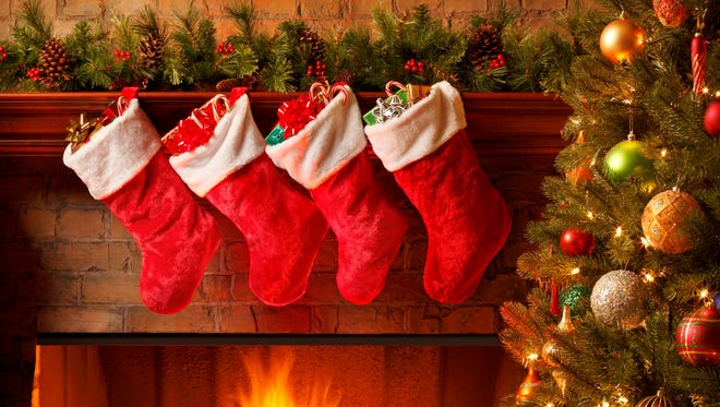 Christmas stockings hanging from a mantelpiece.To see more holiday images click on the link below: