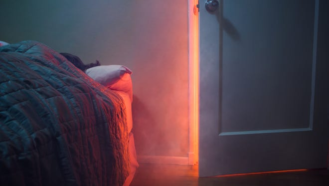 Always close the door to a room where a fire is located once everyone is safely evacuated.