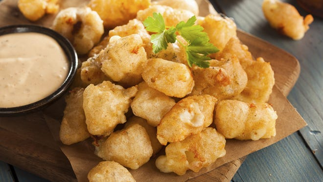 Battered and deep fried cheese curds are a Wisconsin classic.