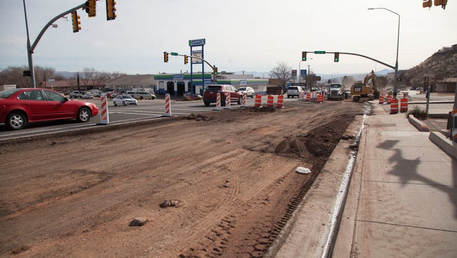 Crews continue expansion work on Bluff Street Thursday, Jan. 18, 2018.