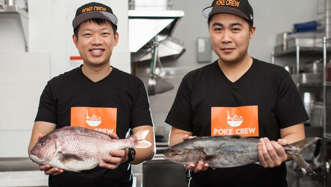 Titus Wang (left) and Yongmook Kim, chef-owners of Poke Crew in Englewood.