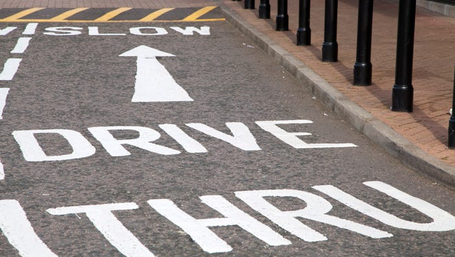 Drive Thru sign painted on the road at a fast food restaurant