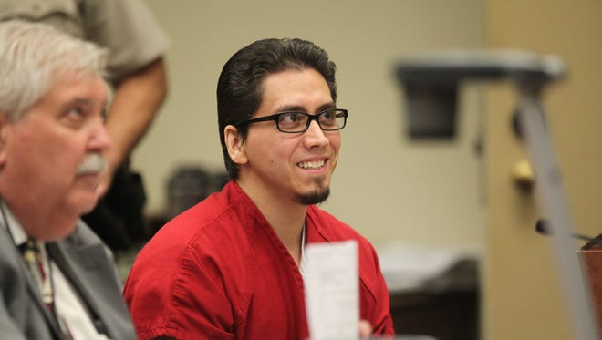 Ernesto Martinez, a twice convicted murderer, smiles before his sentencing hearing on Friday, April 27. Martinez was sentenced to life in prison, but has already been sentenced to death in Arizona, so he will now be sent to Arizona Death row.