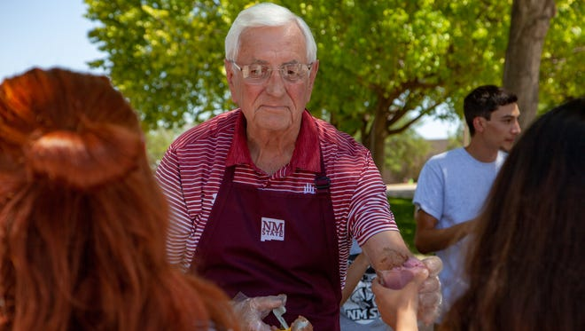 New Mexico State University Chancellor Garrey Carruthers hands out gelato to students Tuesday afternoon outside Corbett Center at New Mexico State University on May 8, 2018. Carruthers will retire next month and a new chancellor is expected to be named on Friday.