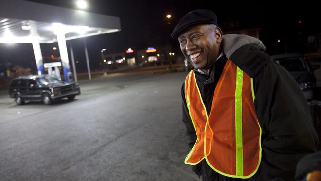 Reverend Charles Harrison, head of the Ten Point Coalition, stands in front of the Marathon gas station with a small group Wednesday, November 13, 2013.   The coalition walks through the neighborhoods talking to residents and keeping the peace.  Danese Kenon/The Star