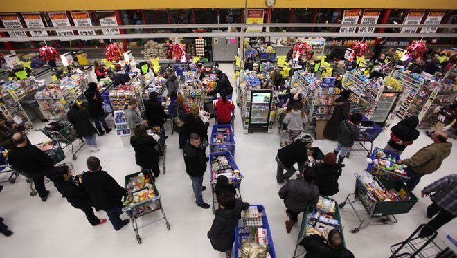 Customers wait in line to check out at ShopRite of Hackensack in a 2015 photo.