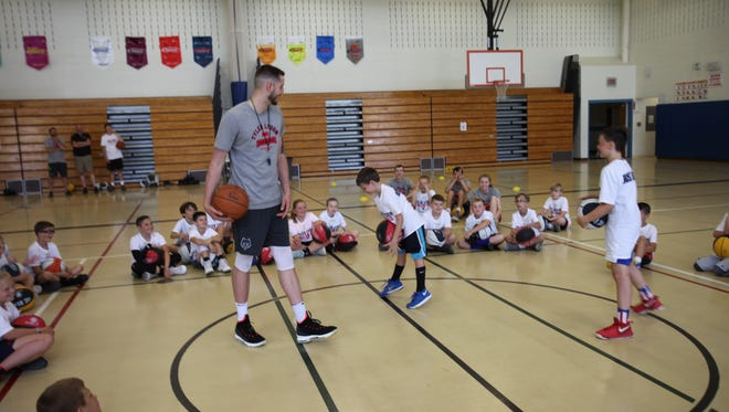 Tyler Lydon gives instructions to a group of youngsters during dribbling drills at his Pine Plains basketball camp on Monday.