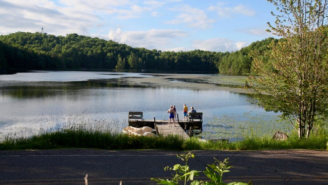 Bass Lake sits at the base of Timm's Hill, Wisconsin's highest natural point.