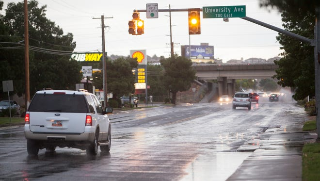 FILE PHOTO: St. George drivers navigate flooding on 700 South Thursday, July 12, 2018. The car in this photo was not the car involved in the September 22, 2020 accident.