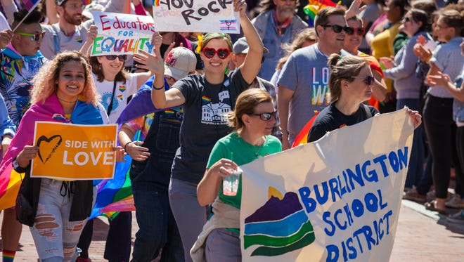 Staff and students of Burlington School District make a colorful splash in the parade