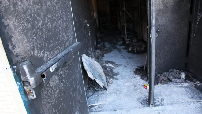 Fire doors at Simon Kenton High School took the brunt of the heat during a fire late Wednesday night in the athletic training center.