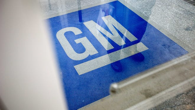 The logo for General Motors decorates the entrance at the site of a GM information technology center in Roswell, Ga.