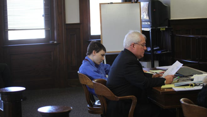 Cody Metzker-Madsen and his attorney during the final day of testimony in the Iowa teen's murder trial.