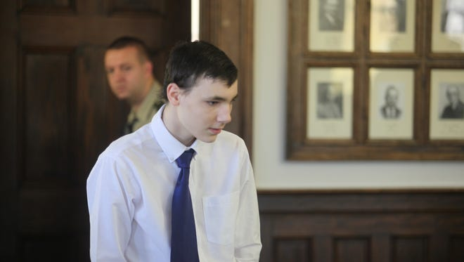 Cody Metzker-Madsen, 18, enters the courtroom at the start of his trial this morning.