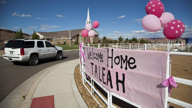 Friends, family and members of the community gather to welcome Taleah Stevenson, who has been fighting cancer for years. Thursday, Sept. 18, 2014.
