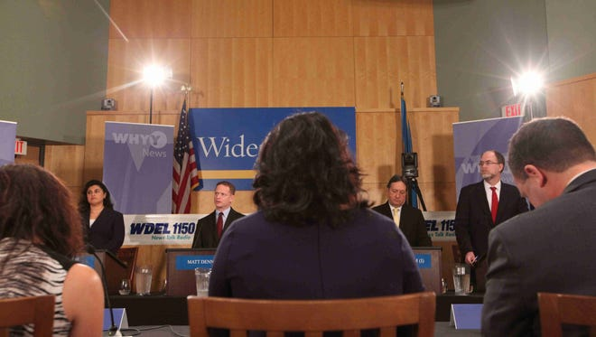 Candidates Catherine Damavandi (G), Matt Denn (D), David Graham (I) and Ted Kittila (R) for the Delaware Attorney General debate at Widener University School of Law campus Wednesday, October 15, 2014.