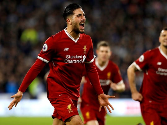 Liverpool's Emre Can celebrates scoring his side's first goal of the game against Huddersfield Town during their English Premier League soccer match at the John Smith's Stadium in Huddersfield, England, Tuesday Jan. 30, 2018. (Martin Rickett/PA via AP)