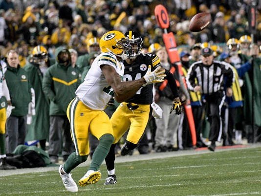 FILE - In this Nov. 26, 2017, file photo, Green Bay Packers wide receiver Davante Adams (17) makes his way through the defense to score a touchdown after making a catch as he plays in an NFL football game against the Pittsburgh Steelers, in Pittsburgh. The Green Bay Packers' best shot to return to the playoffs involves winning their last five games of the season, starting Sunday against the last-place Tampa Bay Buccaneers.(AP Photo/Don Wright, File)