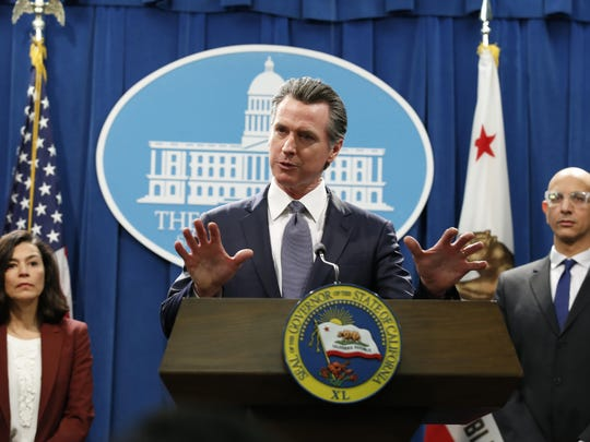 California Gov. Gavin Newsom speaks to reporters about the state's response to the coronavirus during a news conference in Sacramento, Calif. Newsom, a Democrat who leads the nation's most populous state, has won praise from both sides of the aisle for his approach to the crisis, though he's been less aggressive than some other governors and local leaders.