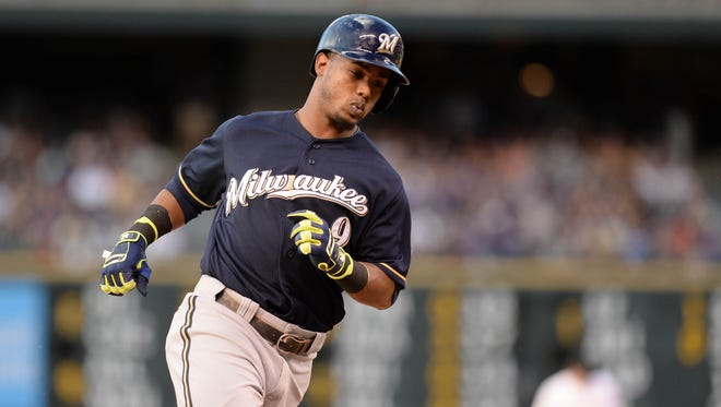 Milwaukee Brewers shortstop Jean Segura (9)  rounds the bases after his solo home run in the third inning against the Colorado Rockies at Coors Field.