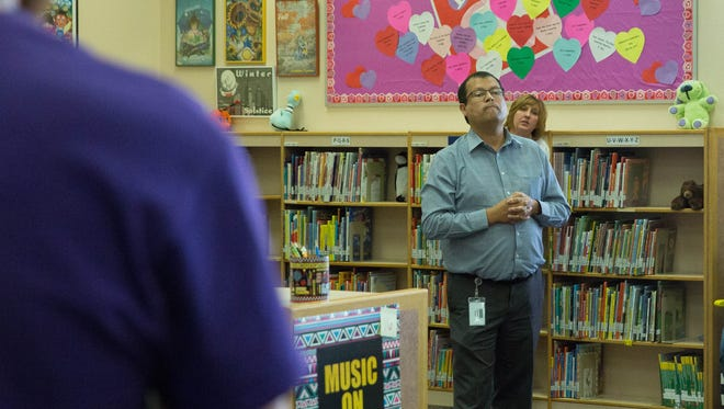 Miguel Serrano, chief human resources officer, listens as parents voice their concerns and questions about the reassignment of Jamie Vance, the principal of Desert Hills Elementary. Friday, Feb. 8, 2018.