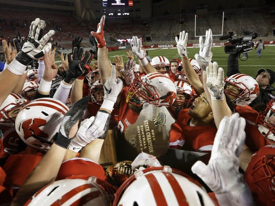 Kimberly players hold up four fingers, to represent