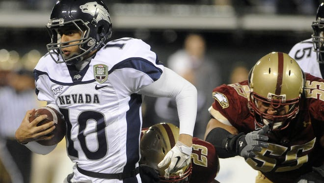 Wolf Pack quarterback Colin Kaepernick runs the ball during the 2010 Kraft Fight Hunger Bowl.