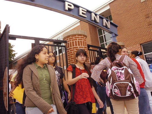Seventh-graders exit Hannah Penn Middle School at the end of the first day of school in 2007. The school, now K-8, will open two days later than other York City schools after mold was discovered.