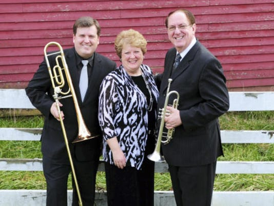 The southern gospel trio The Hyssongs will perform this Friday at the Marion Mennonite Church at 7 p.m.
