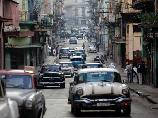 Classic American cars used as collective taxis drive