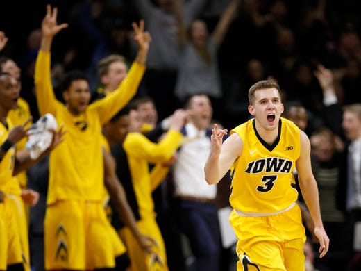 Michigan State prevails in dogfight with Iowa
