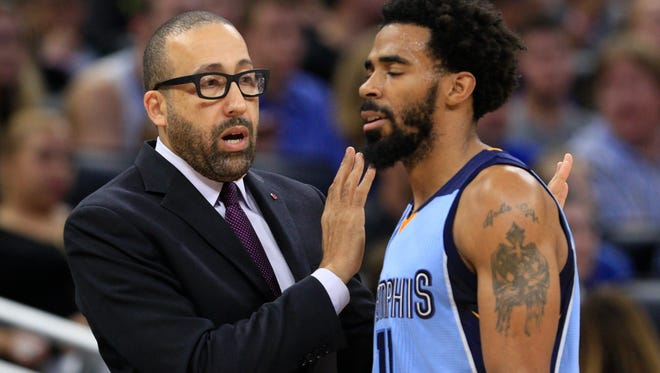 Dec 26, 2016; Orlando, FL, USA;  Memphis Grizzlies head coach David Fizdale (left) talks to Memphis Grizzlies guard Mike Conley (11)  the second quarter of an NBA basketball game against the Orlando Magic at Amway Center. Mandatory Credit: Reinhold Matay-USA TODAY Sports