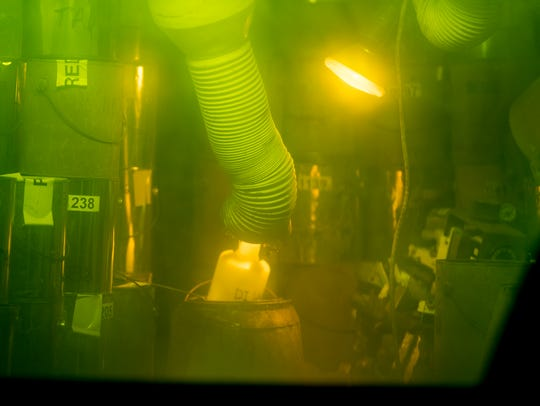 A manipulator works inside a radioactive hot cell at