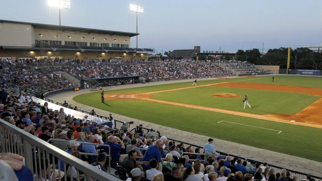 A sellout crowd at MGM Park watches the debut home game for the Biloxi Shuckers on Saturday.