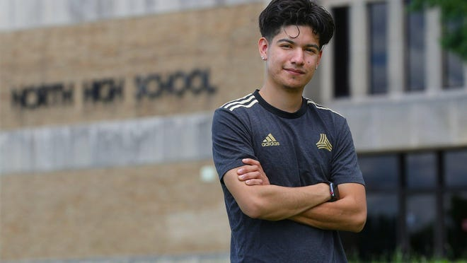 Juan Rodriguez, a 2018 graduate of North High School and a soccer coach for his alma mater, stands outside the school Thursday in Akron. The Supreme Court's decision to reject the Trump administration's attempt to disband DACA means Rodriguez can continue to work and buy a home for his family without fear of deportation -- for now.