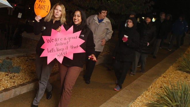 "Parsippany Troy-Hills teachers Deirdre Wilson, left, and Seema Goldberg take part in the ""Rally for Sanity"", Thursday."