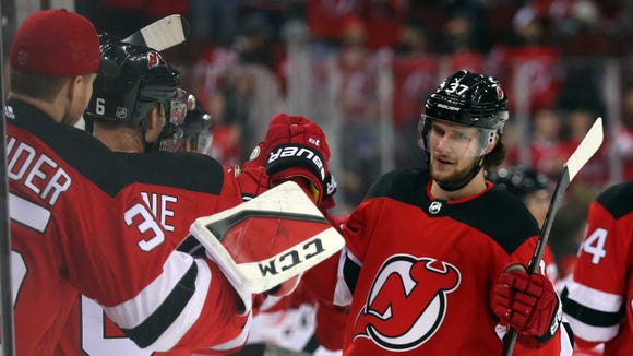 New Jersey Devils center Pavel Zacha (37) celebrates his goal during the first period of their game against the Carolina Hurricanes at Prudential Center.