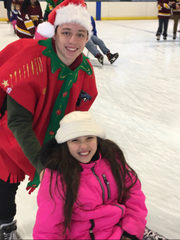 Michael Mania of Central Regional dressed in festive attire at the Golden Eagles Annual Holiday Skate.