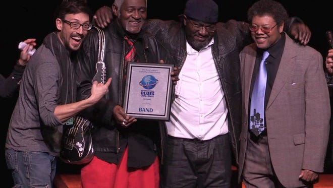 The Norman Jackson Band receives the third place award in the International Blues Challenge, Jan. 30 at the Orpheum Theatre in Memphis. The players (from left): Rick Shortt, Norman Jackson, Ron ÒBoogiemanÓ Brown and Danny Williams.