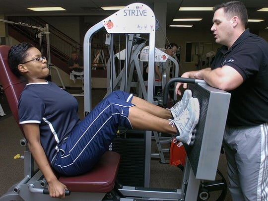 Cynthia Ward receives instruction from personal training director Jon Greene at the Downtown YMCA in 2007.