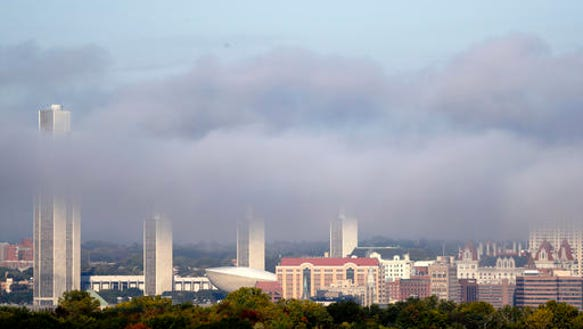 Morning fog burns off in downtown Albany on Wednesday,