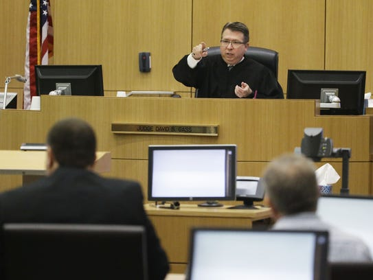 Judge David B. Gass listens to arguments on whether