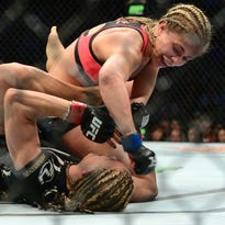Paige VanZant, top, won a one-sided unanimous decision over Felice Herrig.