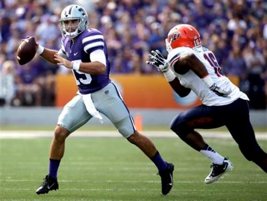 Kansas State quarterback Jake Waters (15) looks for