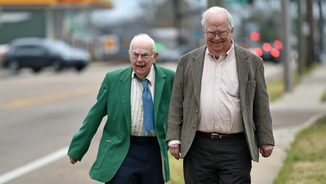 Brothers Donald, left, and Oliver Triplett take a walk in Forest Thursday. Donald, 82, is the first person ever diagnosed with autism.