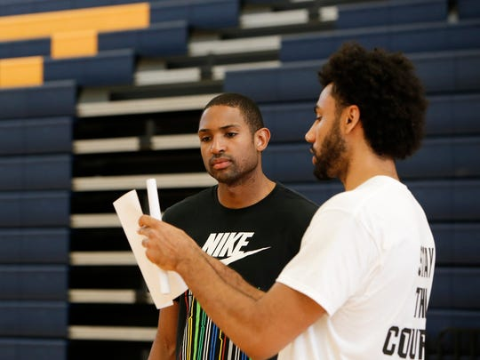 Brothers Al, left, and Jon Horford go over plans at