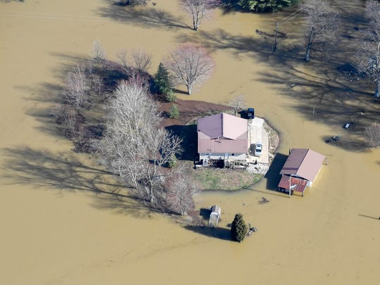 Home surrounded by water in the Beals area as the flooding Ohio River nears historic levels in the Tri-State Tuesday, February 27, 2018.